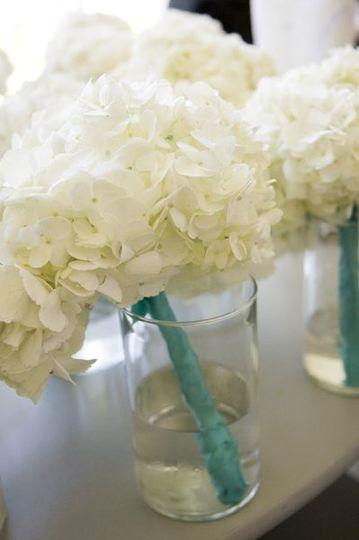 Simple white bouquets of hydrangea.