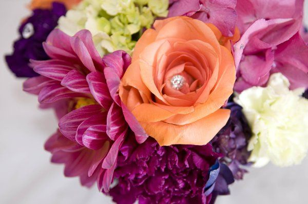 Bright bouquet of roses, hydrangea, carnations, and dahlias.