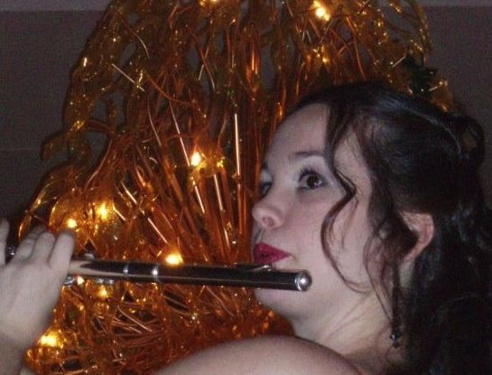 Playing flute.