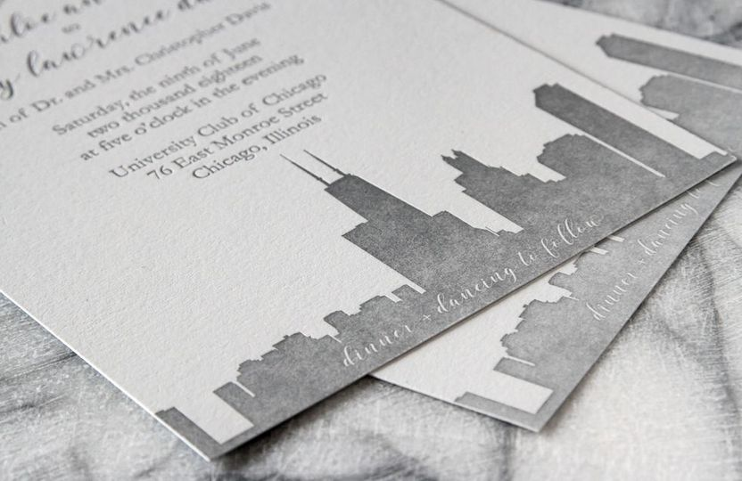 Letterpress wedding invitation suite printed with Chicago skyline.