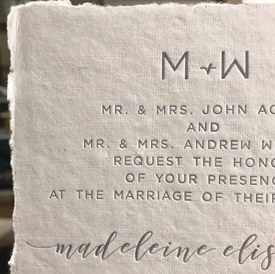 Letterpress wedding invitation on handmade cotton rag paper.