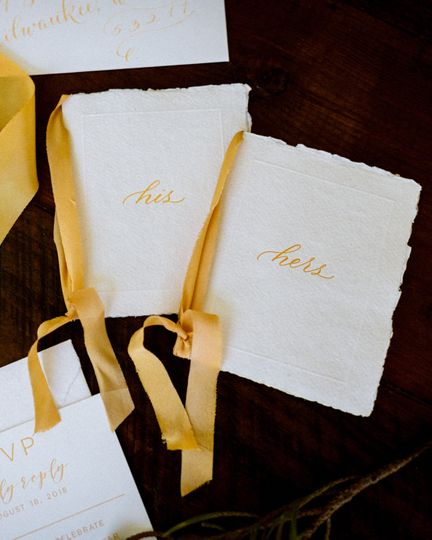 Custom letterpress printed vow books with hand dyed silk ribbon and spot calligraphy from Bien Fait...