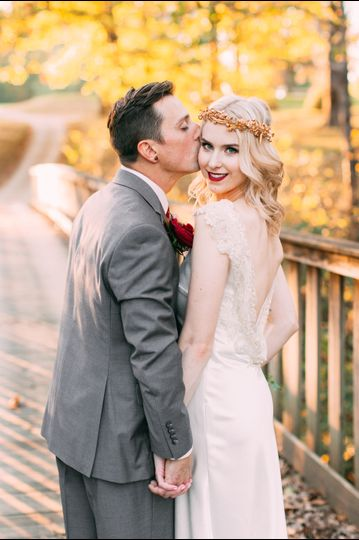 Blonde bride with gold crown and groom in grey suit at Kittanning Country Club