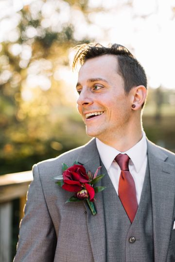 Groom in grey suit and red tie at Kittanning Country Club