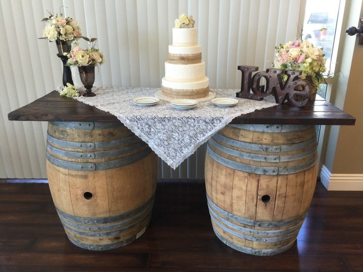Wedding cake table featuring vintage barrels