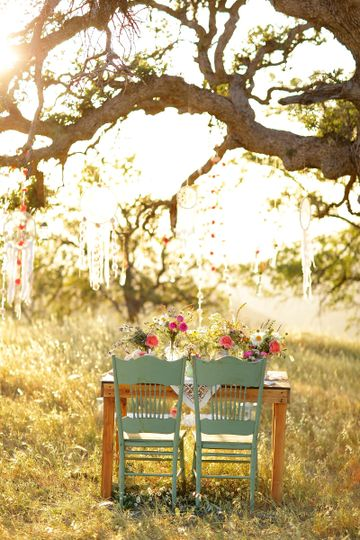 Boho Sweetheart table with wild flowers, garland & dreamcatchers at Figueroa Mountain, Los Olivos,...