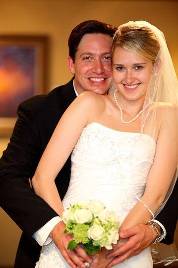 Groom hugging his bride