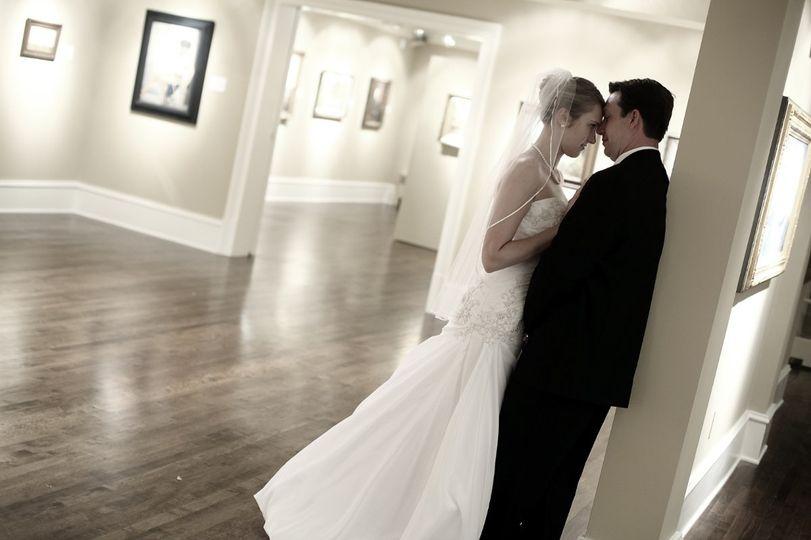 Bride leaning on her groom