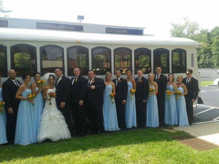 Newlyweds and their guests outside the trolley