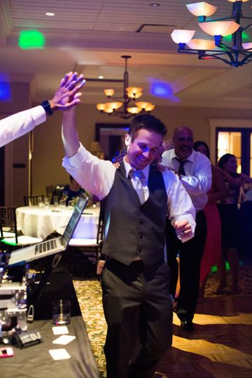 A high-five from the groom
