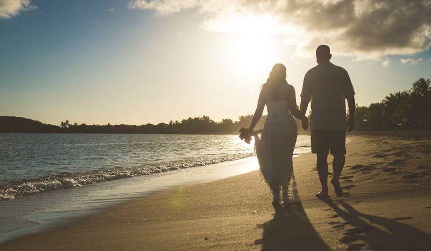 Couple walking in the seashore