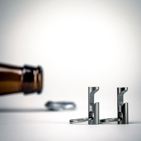 Stainless steel modern bottle opener keychain.
