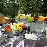 BBQ Smokehouse catering cheese and fruit stations are displayed with finesse, promptly maintained...