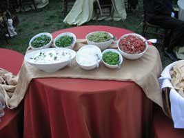The salsa bar designed for a BBQ wedding with a Southwestern theme. Mix and match Southwestern,...