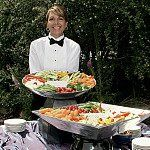 Choose formal attire for servers if you like or go casual (black t-shirts and slacks) to create the...