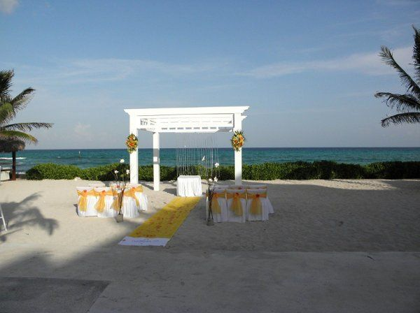 yellow wedding setup at El Dorado Royale in Riviera Maya, Mexico