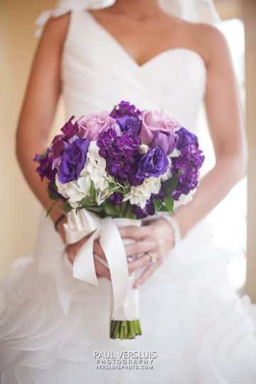 Bride holding a purple bouquet