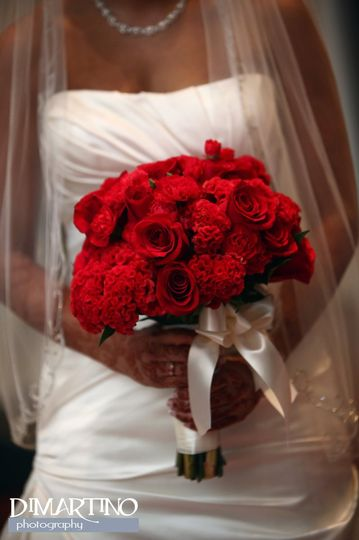 Bride holding a red bouquet