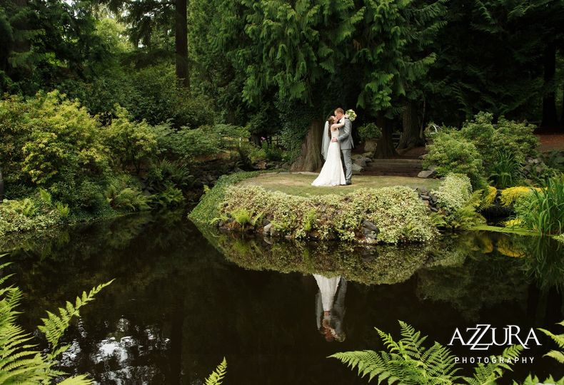 Newlyweds by the pond