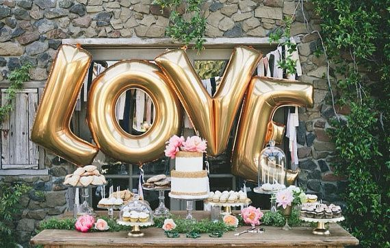 LOVE spelled out with the megaloon balloon letters! Perfect for your dessert table or a lovely...
