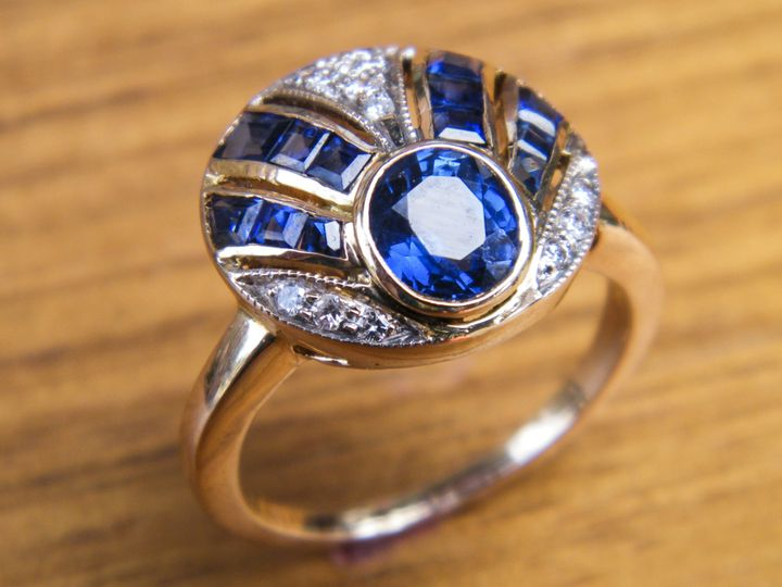 A beautiful antique Art Deco piece realized in yellow gold, diamonds, and sapphires.