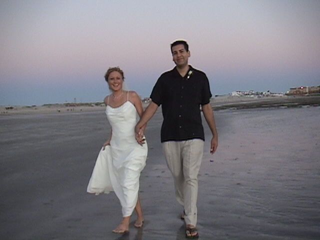 ddc2e2e256989be0 Gary Sharon just married walking on the beach at sunset