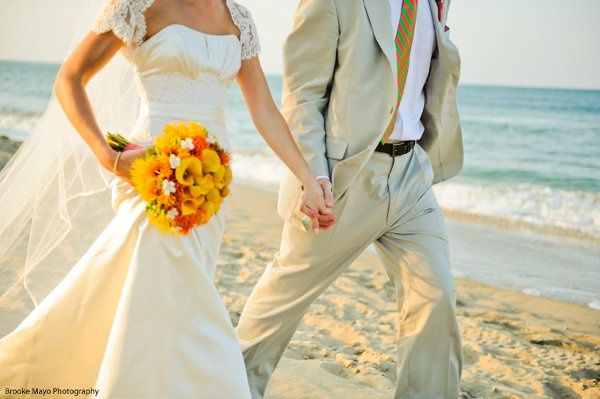 Newlyweds walking by the shore