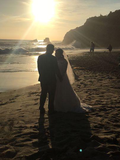 Amazing sunset wedding on the sand!