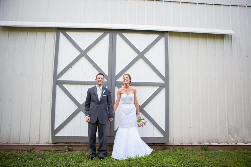 Couple in front of the barn