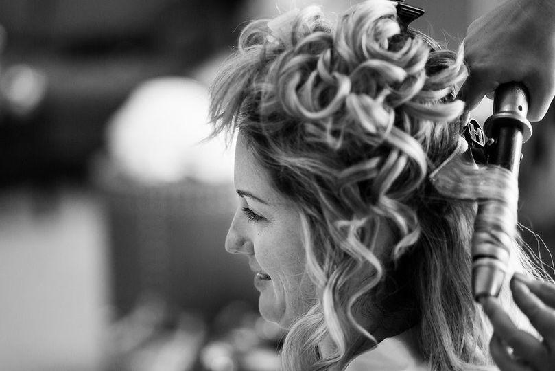 Curling her hair