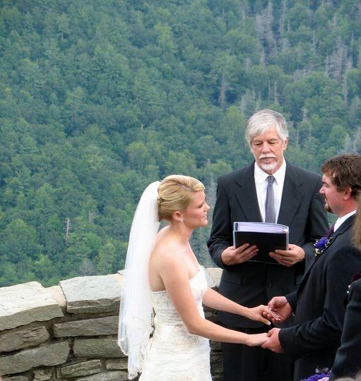 Rev. Tom Johanson of HeartLight Weddings performs a wedding at Wiseman's Overlook in Linville Falls,...