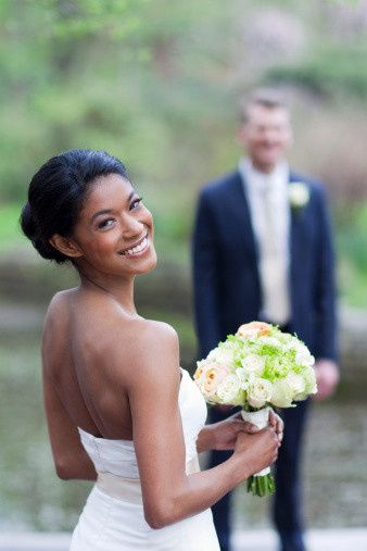 Bride and her groom in the back