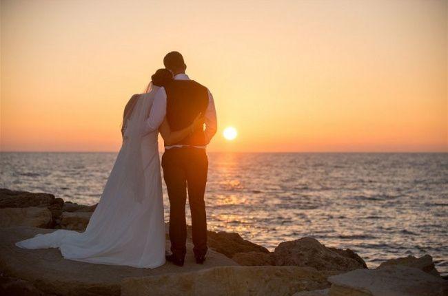 Newlyweds enjoying sunset