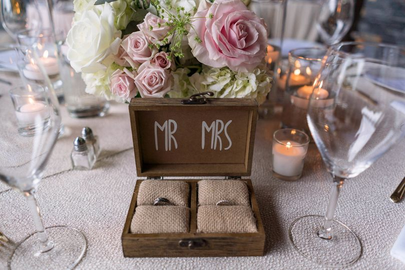 wedding rings on table set up ceremony41of169 51 354519 159883431639248