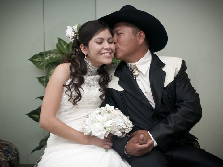Latina bride with her father