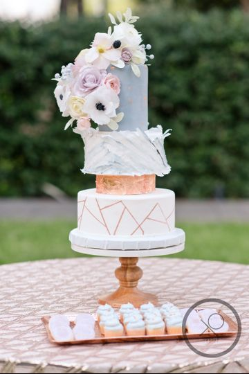 XO cakery | four tier wedding cake with rose gold geo accents, wafer paper edible blooms +...