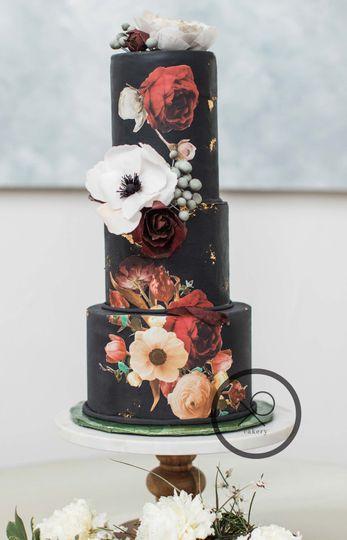 XO cakery | three tier black wedding cake with a vintage boho vibe