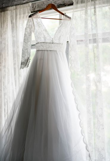 white wedding dress hanging by the window p9ytgj6 51 1895519 157372108538207