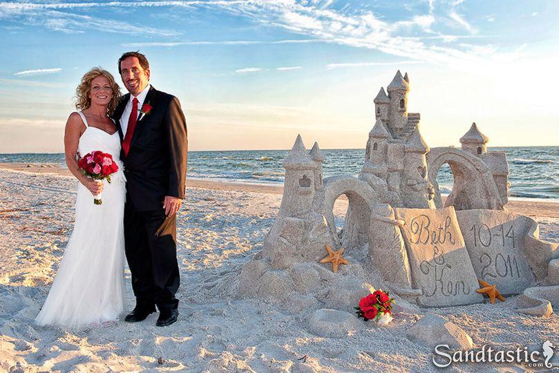 Beach wedding sand sculpture.