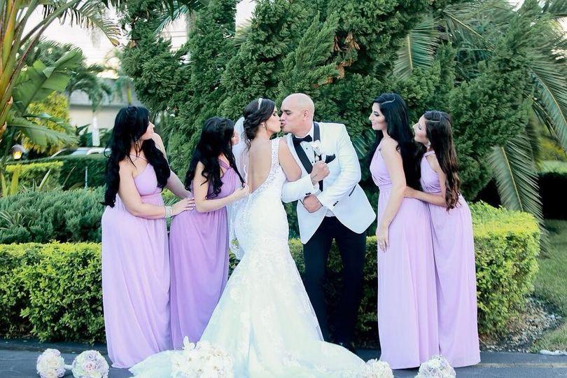 Sweet newlyweds with bridesmaids