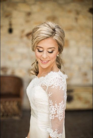 Bride in a lace sleeved wedding dress