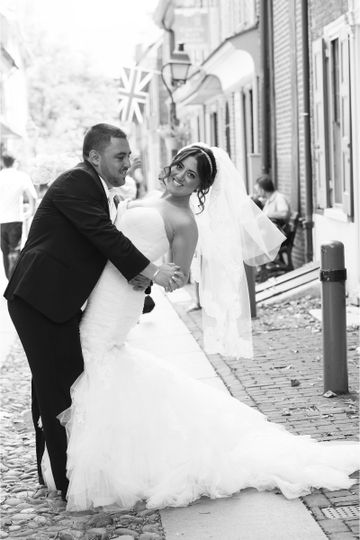 Groom dipping his bride