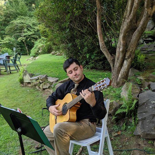 Sam Irvin performs at wedding