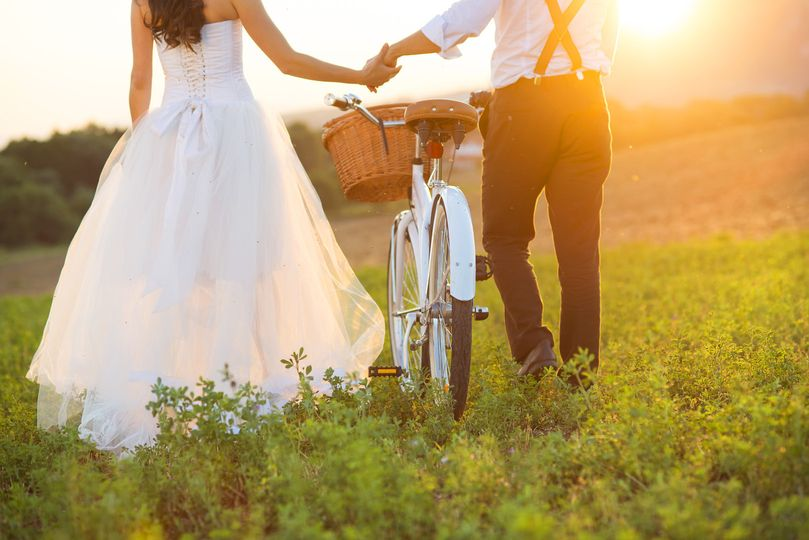 Couple walking with a bike