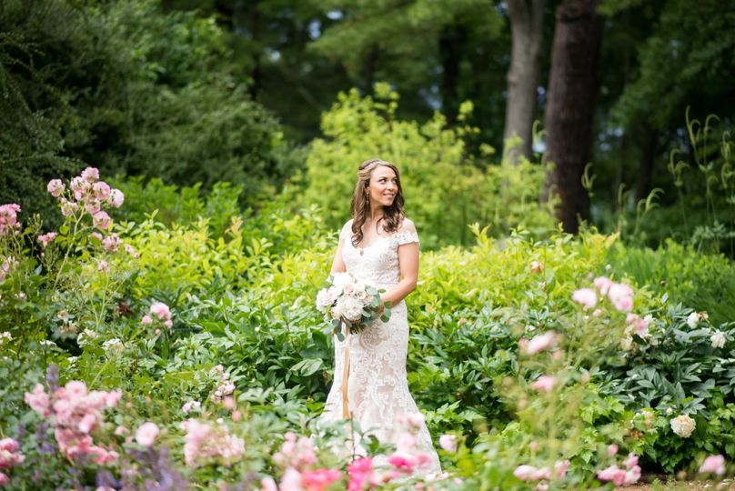 Beautiful bride surrounded by lush flora