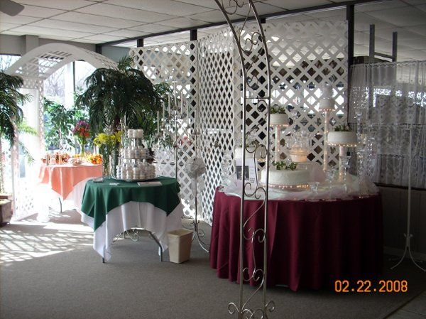 Lattice backdrops with a lighted cake