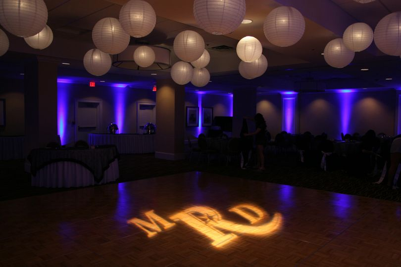 Purple uplights and monogram projection
