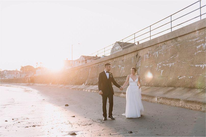 Happy couple beach stroll