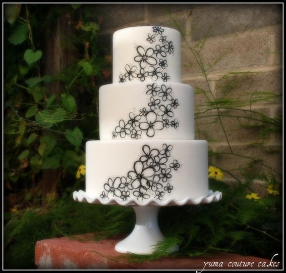 Hand painted whimsical daisies on fondant.