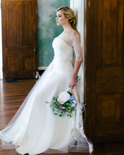 Bride posing by the doorway